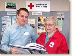 American Red Cross Greater Rochester NY Chapter Emergency Services Director Leighton Jones and CERT Team & Volunteer Leader Pam Hatch review disaster education options as they plan for the ongoing Red Cross training for the CERT team.